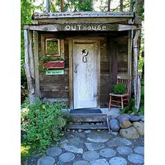 Whoever owns this outhouse might brag about their outdoor plumbing as it's the most charming outhouse I've seen.